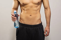 Closeup of man holding bottle of water Royalty Free Stock Photography