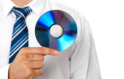 Closeup of a man holding compact disc. Isolated on white background Stock Photo