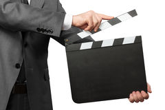 Closeup of man holding movie clapper board on white. Male hands holding movie clapper board isolated on white background Royalty Free Stock Photo