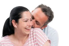 Closeup of man kissing woman neck and hugging. Closeup of men kissing women neck and hugging as romantic couple concept isolated on white studio background royalty free stock photo