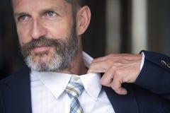 Closeup of man loosens his shirt Royalty Free Stock Photos