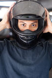 Closeup of a man with a motorcycle helmet Stock Images