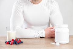 Closeup on a man with nutrition supplements on table Stock Images
