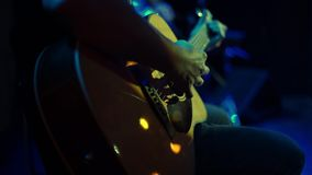 Closeup of man playing acoustic guitar on rock concert stock video