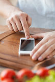 Closeup of man pointing finger to smartphone Royalty Free Stock Image