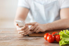 Closeup of man pointing finger to smartphone Stock Photo