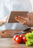 Closeup of man pointing finger to tablet pc Stock Photos