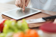 Closeup of man pointing finger to tablet pc Stock Image
