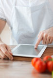 Closeup of man pointing finger to tablet pc Royalty Free Stock Photo