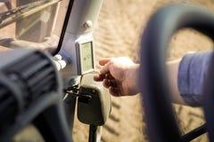 Closeup man points to display screen through steering-wheel Stock Photo