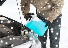 Closeup of man pouring antifreeze into car Stock Photo