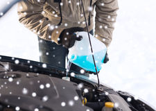 Closeup of man pouring antifreeze into car Royalty Free Stock Image