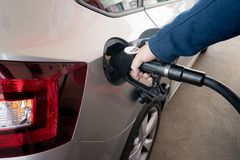 Closeup of man pumping diesel fuel for diesel engines in car at Stock Photography