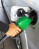 Closeup of man pumping gasoline fuel in car Stock Images