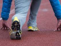 Closeup of man running shoes. male jogging at stadion Royalty Free Stock Photo