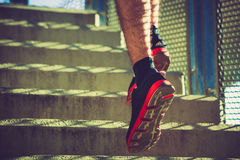 Closeup man running up the stairs outdoor in the city Royalty Free Stock Photo