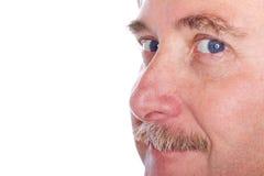 Closeup of a man's face stock photography