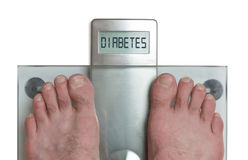 Man`s feet on weight scale - Diabetes. Closeup of man`s feet on weight scale - Diabetes Royalty Free Stock Photo