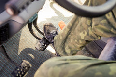 closeup man's foot presses gas pedal under instrument panel Royalty Free Stock Photo