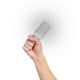 Closeup of man's hand holding energy saving lamp. Glows brightly Stock Photography