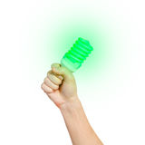 Closeup of man's hand holding energy saving lamp. Glows brightly Royalty Free Stock Photography