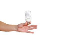 Closeup of man's hand holding energy saving lamp. Recycling, ele Royalty Free Stock Photos