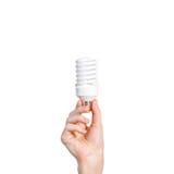 Closeup of man's hand holding energy saving lamp. Recycling, ele Stock Image