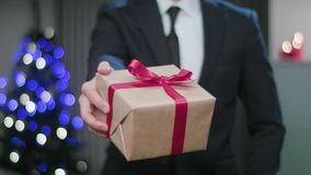 Man`s Hands Holding a Christmas Gift stock image