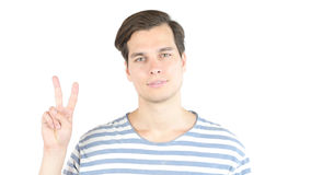 Closeup man's hand showing victory v sign. High quality Royalty Free Stock Photos
