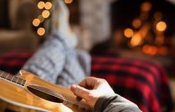 Closeup of man`s hand strumming guitar Royalty Free Stock Photography