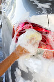 Closeup man's hand washing a car. Stock Images