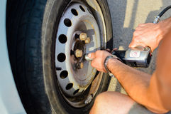 Closeup of man's hands changing old wheel with Stock Image