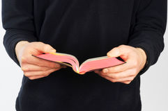 Closeup of mans hands holding prayer book Royalty Free Stock Photo