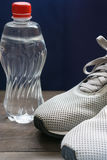 Closeup of man& x27;s sneakers with water bottle. Closeup of man sneakers toes with water bottle. low angle view. mandatory sport goods for running Stock Image