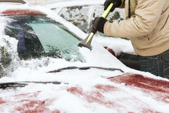 Closeup of man scraping ice from car Royalty Free Stock Photos