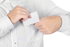 Closeup of man in shirt attach badge card isolated Stock Photo