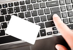 Closeup of a man shopping online using laptop Stock Images