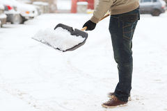 Closeup of man shoveling snow from driveway Stock Images