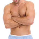 Closeup on man showing muscles of torso and biceps Stock Photo