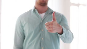 Closeup of man showing thumbs up Stock Images