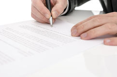 Closeup of a man signing a contract Royalty Free Stock Photography