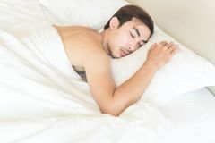 Closeup man sleeping on bed, health care and medicalconcept, sel. Closeup man sleeping on bed, health care and medical concept, selective focus Royalty Free Stock Photos