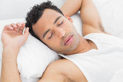 Closeup of a man sleeping in bed Stock Photography
