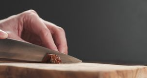 Closeup man slicing sundried tomatoes. Wide photo Royalty Free Stock Image