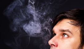 Closeup of a man smoking. Isolated on gray background Stock Photo