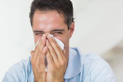 Closeup of a man suffering from cold Stock Photos