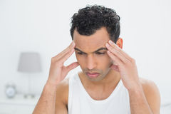 Closeup of a man suffering from headache in bed Royalty Free Stock Images
