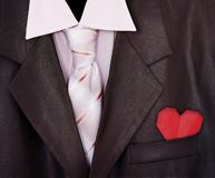 Closeup man suit with red paper heart Royalty Free Stock Photo