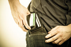 Closeup. Man taking wallet out on his pocket. Pay and theft. Closeup of male hands. Man taking the wallet out on his pocket. Pay and risk of theft. Isolated on Royalty Free Stock Image