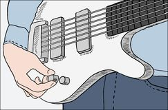 Closeup of man tuning guitar Stock Photo